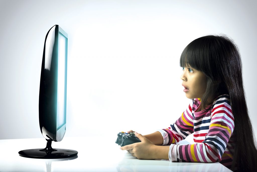 Little girl playing compter games, Kids addicted to the game concept